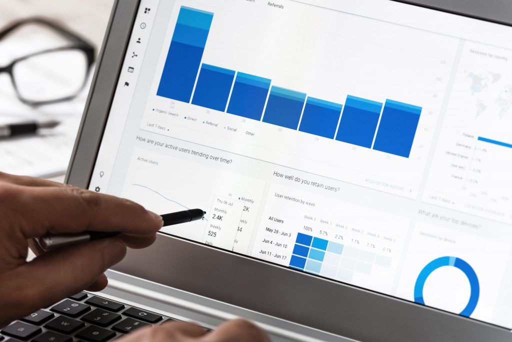 PPC consultant sharing a PPC Campaign report on a screen